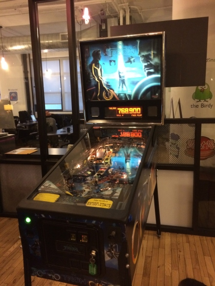 A Tron pinball machine is a must have in a techie office